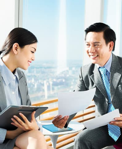 man and woman talking about business