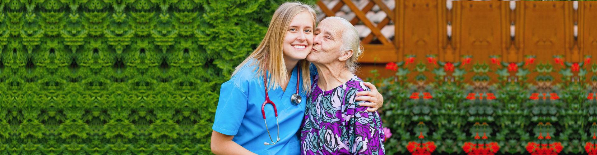 happy senior woman and her nurse