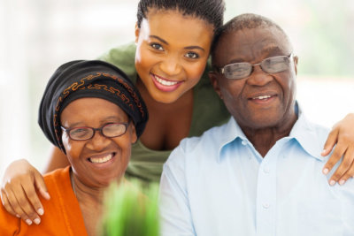 senior couple with their caregiver